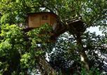 Location vacances Montreuil-le-Gast - Cabanes dans les Arbres du Manoir de l'Alleu-2