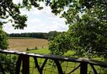 Location vacances Montreuil-le-Gast - Cabanes dans les Arbres du Manoir de l'Alleu-1