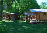 Camping avec Piscine couverte / chauffée Aries-Espénan - Camping Sites et Paysages La Forêt Lourdes-2