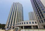 Location vacances Weihai - Dijing Square Seaview Apartment-2