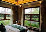 Hôtel Leshan - Leshan Tian Chi Wooden House Hostel