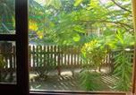 Location vacances Livingston - Flamboyant Tree Apartment 3-3