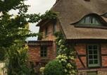 Location vacances Güstrow - Ferienwohnung im Reetdachhaus am Inselsee-2