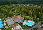 Camping avec Parc aquatique / toboggans Estang - Village Tropical Sen-Yan-1